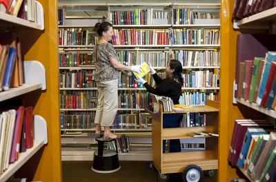Library staff Catherine Werner and Nazira Yusoff w...