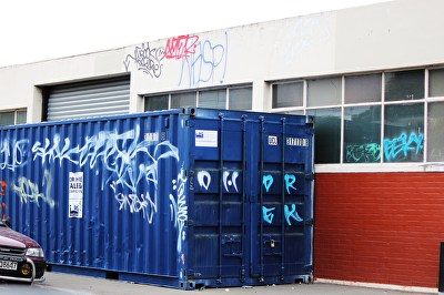 A photograph of tags on a building and shipping co...
